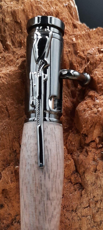 détail fusil gun métal